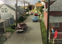 hobby-railroad-street-scene-with-autos-and-house-models