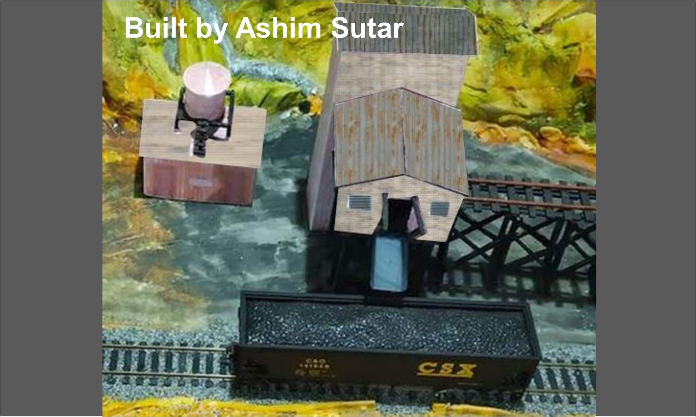 model-mine-structures-alongside-railway-track